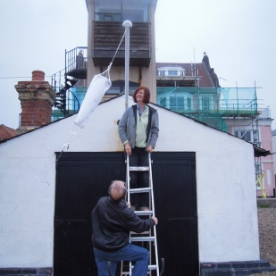 Jane Oldfield installing her Windsock piece