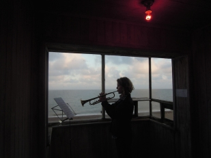 Julia Warr performing on trumpet at the top of the tower during the BROADCAST residency as part of Caro Halford's installation