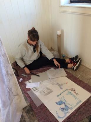 Sarah assessing drawings
