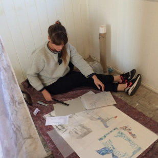 Sarah assessing drawings